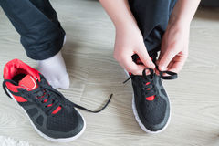The boy running shoes laces. The boy running shoes is a laces stock photos