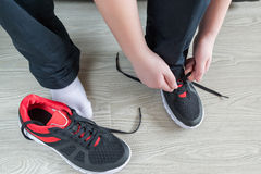 The boy running shoes laces. The boy running shoes is a laces royalty free stock image