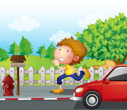A boy running at the street with a mailbox Stock Images