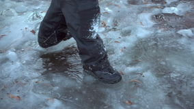 Boy running on thin ice, slow motion stock video footage