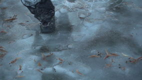 Boy running on thin ice, slow motion 250 fps stock footage