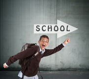 Boy running to school Royalty Free Stock Photo
