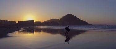 Boy running to the sea to do bodyboard Stock Image