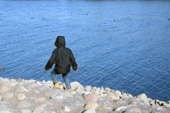 Boy running to the water Stock Images