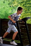 Boy running on treadmill Royalty Free Stock Photo