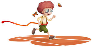 A boy running with two butterflies Stock Image