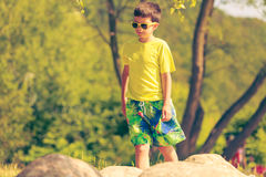 Boy running walking outdoor. Stock Image