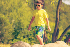 Boy running walking outdoor. Stock Images