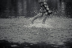 Boy running on water Royalty Free Stock Images
