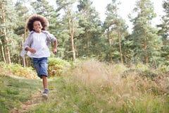 Boy Running Through Woods Royalty Free Stock Image