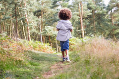 Boy Running Through Woods Stock Photo