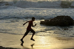 Boy runs along the shore. Of the Mediterranean Sea in Israel Royalty Free Stock Photography