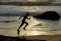 Boy runs along the shore. Of the Mediterranean Sea in Israel Stock Photos