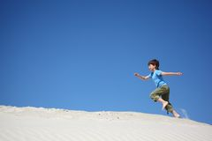 Boy runs on sand Royalty Free Stock Photos