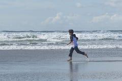 Boy runs in the sand. Royalty Free Stock Photos