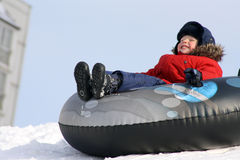 The boy rushing. On snow on tubing Royalty Free Stock Photo