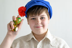 Boy in Russian national cap with cloves holding easter eggs Stock Images