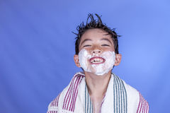 Boy's big shaving cream smile. Royalty Free Stock Image