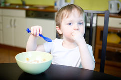 Boy's breakfast. Little boy eating cereals with milk Stock Images