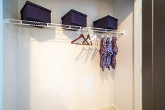 Boy`s closet with hangers. Boys closet with dress shirts and hangers stock photo