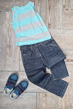 Boy's clothing on the floor Stock Photo