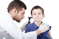 Boy's ear examination Royalty Free Stock Photography