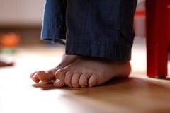 Boy`s feet on the floor stock photos