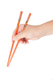 Boy's hand holding Japanese chopsticks Royalty Free Stock Photo