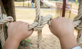 Boy`s hand holding a rope Stock Images