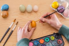 Boy´s hand painting easter eggs royalty free stock photo