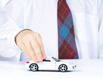 Boy's hand with white toy car Royalty Free Stock Image