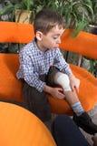 Boy's leg bandage Stock Images