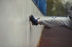 The boy`s leg hits the wall of the basketball field. The boy lost the game Stock Images