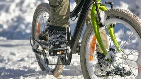 Boy`s legs and bicycle Royalty Free Stock Photos