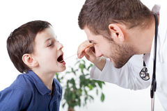 Boy's mouth examination Royalty Free Stock Image