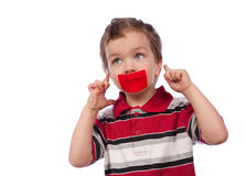 The boy's mouth by red tape Royalty Free Stock Images