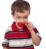 The boy's mouth by red tape Stock Image