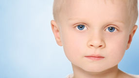 Boy`s ook. 5 years old boy with interesting look stock images