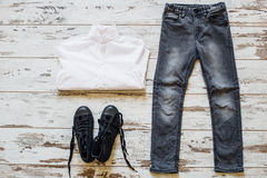 Boy's outfit on wooden floor top view Stock Image