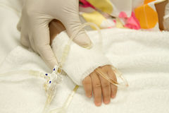 Boy's patient  in the hospital with saline intravenous (iv) dri Royalty Free Stock Photos