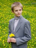 Boy's portrait. On dandelions background Royalty Free Stock Images