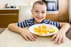 The boy`s portrait is in front of him orchard dish. Royalty Free Stock Image