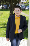 The boy`s portrait in a yellow shirt at colons Stock Photo