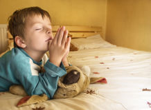 A boy's prayer. Little boy praying at bedtime Royalty Free Stock Images