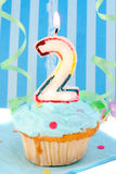 Boy's second birthday. Baby boy's second birthday cupcake with blue frosting and  decorative background Stock Images