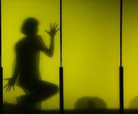 Boy's shadow. On yellow acrylic panel royalty free stock image