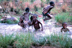 Boy's swimming. After a rain shower in Gabon, West Africa Royalty Free Stock Photos