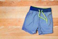 Boy`s swimming trunks. Boy's swimming trunks on wooden background Stock Photography