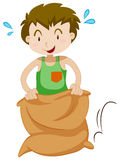 Boy in the sack jumping Stock Photography