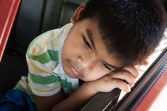 Boy sad alone in the  car Royalty Free Stock Images